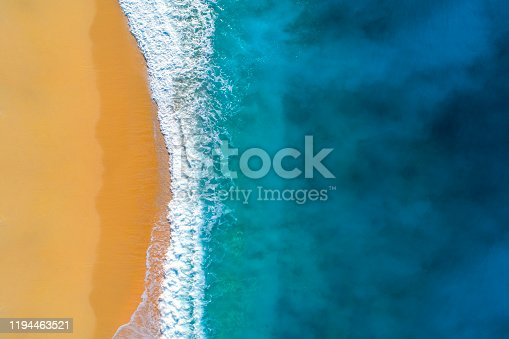 istock Aerial view of clear turquoise sea and waves 1194463521