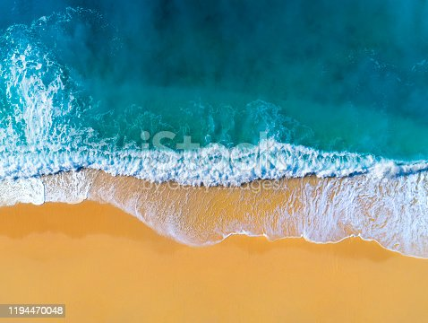 istock Aerial view of clear turquoise sea and waves 1194470048