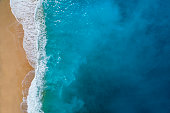 Aerial view of sandy beach, clear turquoise water. Mediterranean sea.