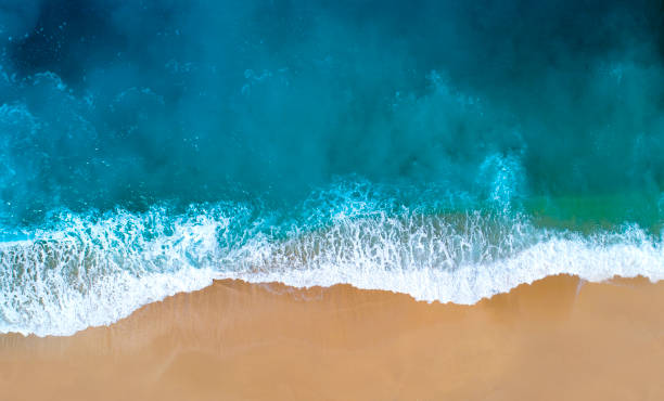 Aerial view of clear turquoise sea Aerial view of sandy beach, clear turquoise water. Mediterranean sea. mediterranean sea stock pictures, royalty-free photos & images
