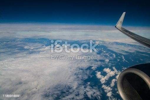 Aerial View of Clouds in the Sky with Plane Engine