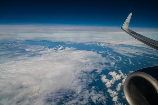 621114928 istock photo Aerial View of Clouds in the Sky with Plane Engine 1185916591
