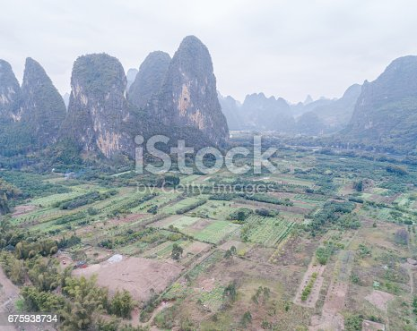 istock aerial view of cloudscape above farmland and mountain 675938734