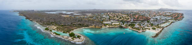 Aerial view of coast of Curacao in the Caribbean Sea with turquoise water, cliff, beach and beautiful coral reef stock photo