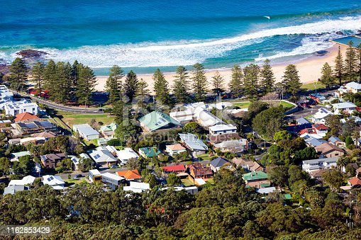 Aerial view of coastline town of Bulli NSW Australia, background with copy space, full frame horizontal composition