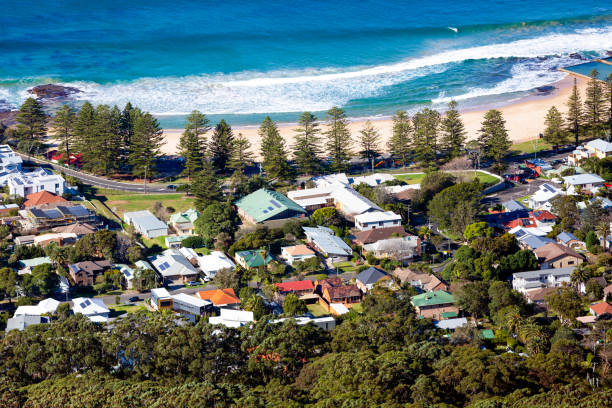 Aerial view of coastline town of Wollongong, background with copy space Aerial view of coastline town of Bulli NSW Australia, background with copy space, full frame horizontal composition headland stock pictures, royalty-free photos & images
