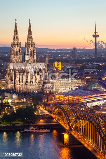 Aerial view of Cologne Cathedral and Hohenzollern Bridge at dusk in Cologne, Germany