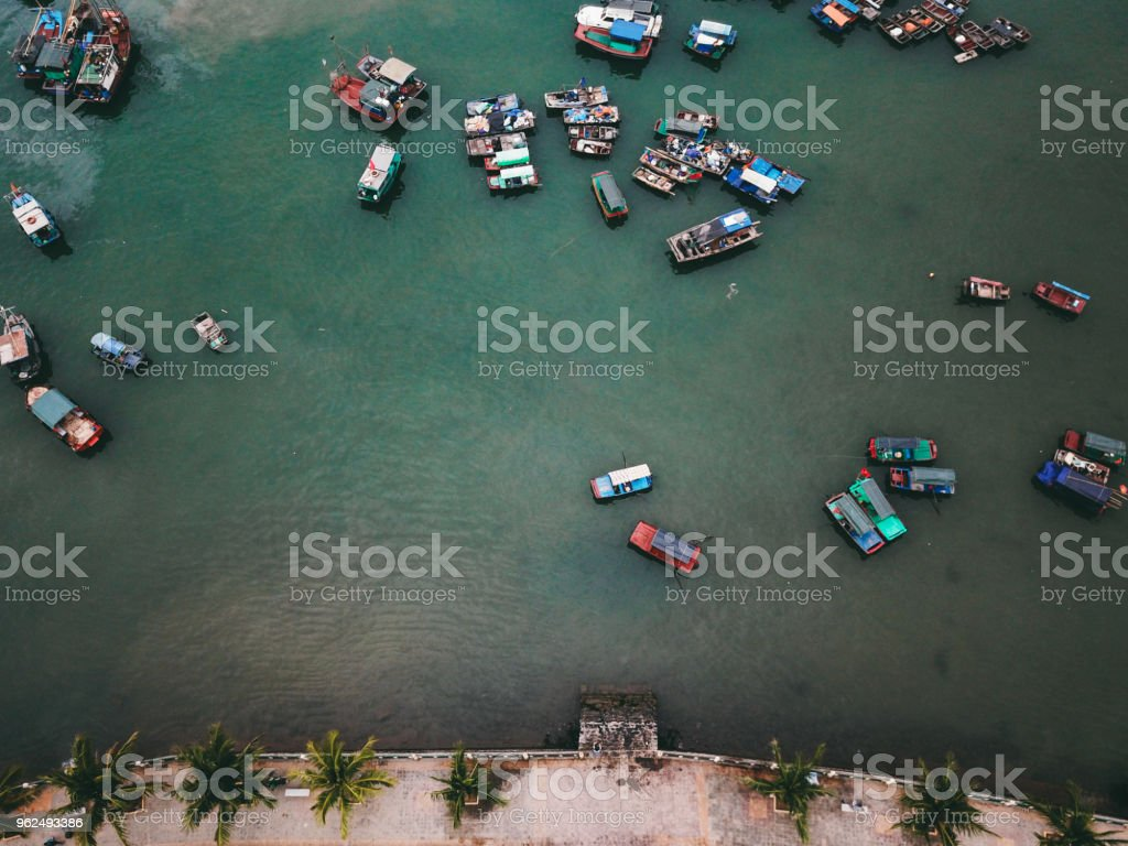 Aerial view of colorful boats and road on Cat Ba island in Vietnam - Royalty-free Aerial View Stock Photo