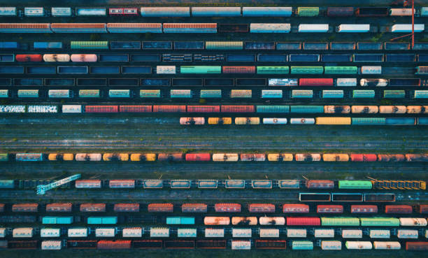Aerial view of colorful freight trains Cargo trains close-up. Aerial view of colorful freight trains on the railway station. Wagons with goods on railroad. Heavy industry. Industrial conceptual scene with trains. Top view from flying drone tramway stock pictures, royalty-free photos & images