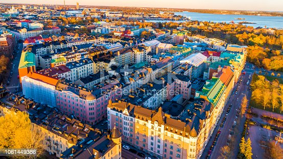 Aerial view of Helsinki city in autumn. The view shows the colorful rooftops and beautiful buildings in Helsinki. Aerial view of city center. The houses are arranged in nice way.