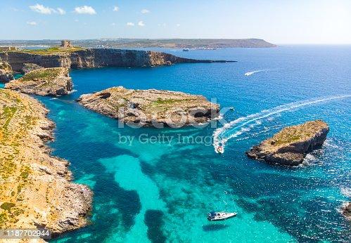istock Aerial view of Comino island and a few boats o the sea. Drone landscape. Europe. Malta 1187702944