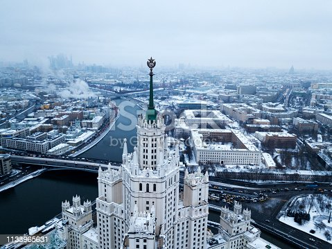 istock Aerial view of communistic star on the top of Stalinist skyscraper, architecture of the USSR, Soviet Union. Winter. 1133965631