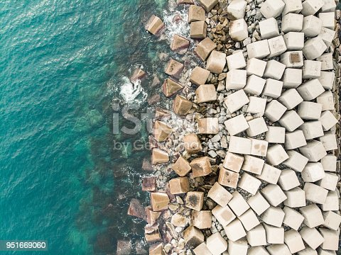 Aerial view of concrete cubes creating breakwater