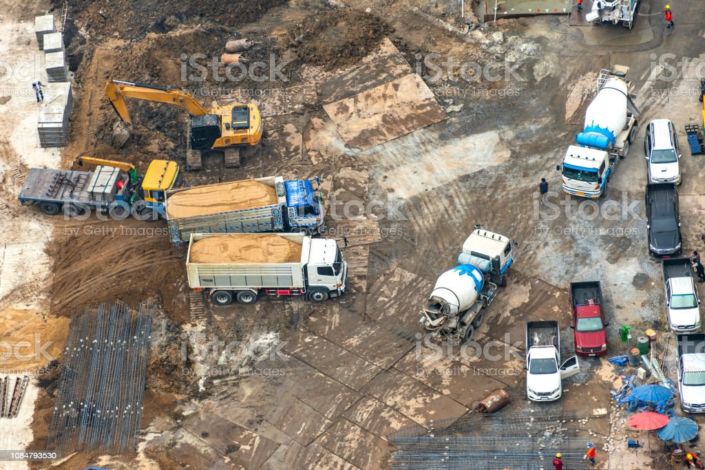 Aerial view of site preparation and construction in progress.