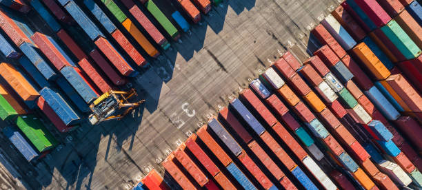 aerial view of container port - container stock photos and pictures