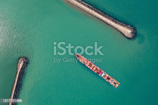 Aerial view of container ship approaching to the port.