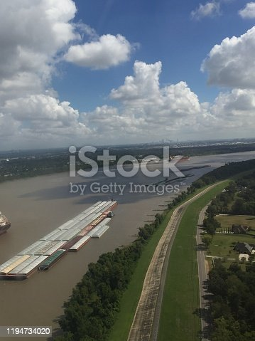 483418977istockphoto aerial view of container ships on river 1194734020
