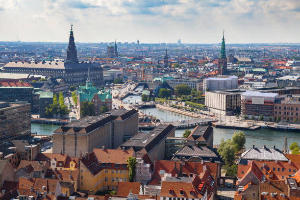Aerial view of Copenhagen red roofs and canal. Churches and palaces of Danish capital. stock photo