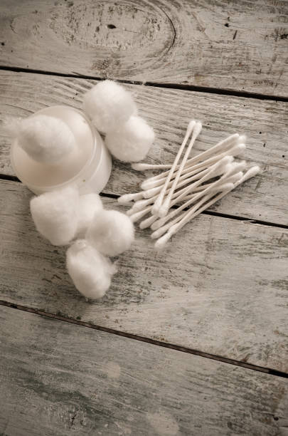 Aerial View of Cotton Balls and Cotton Swabs stock photo