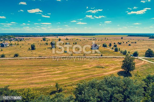 1155573645istockphoto Aerial view of countryside, country road and fields 1021718050