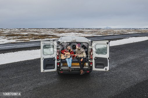istock Aerial view of couple in camper van in Iceland 1068703614
