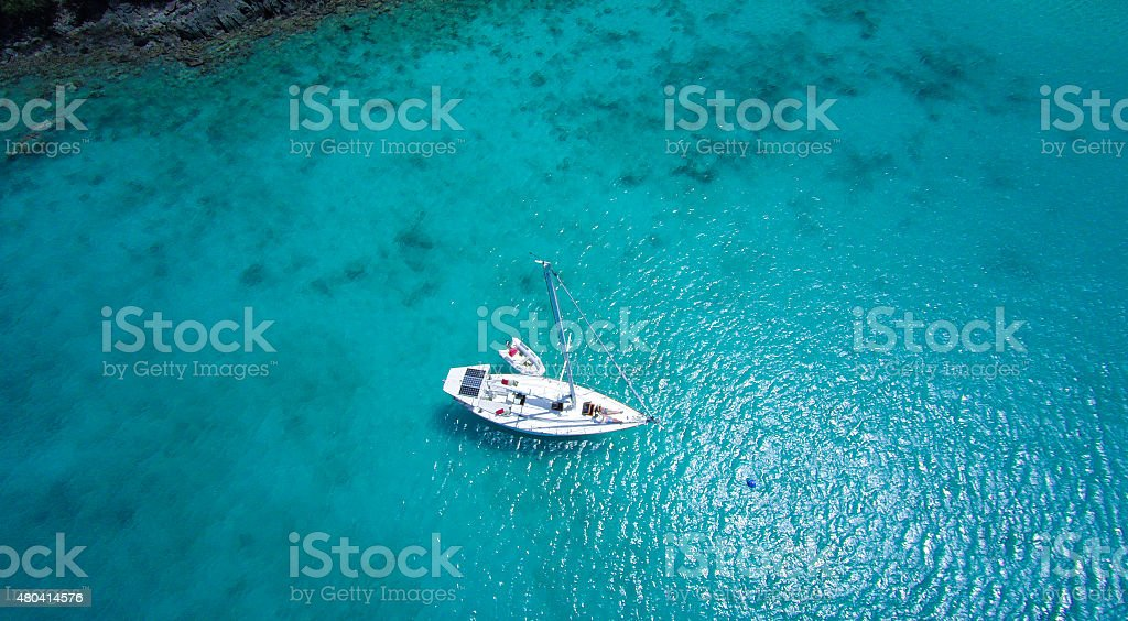 aerial view of couple relaxing on sailboat in the Caribbean stock photo