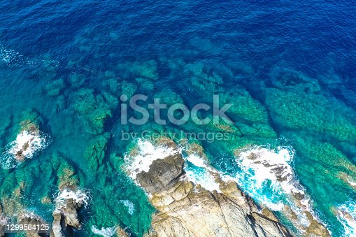 Aerial drone top view of beautiful sea waves and fantastic rocky coast. The concept of calmness, silence and unity with nature