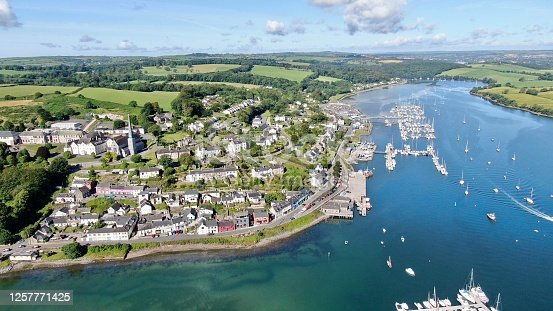 Aerial view of Crosshaven and the Owenabue River with moored yachts and distant landscape.
