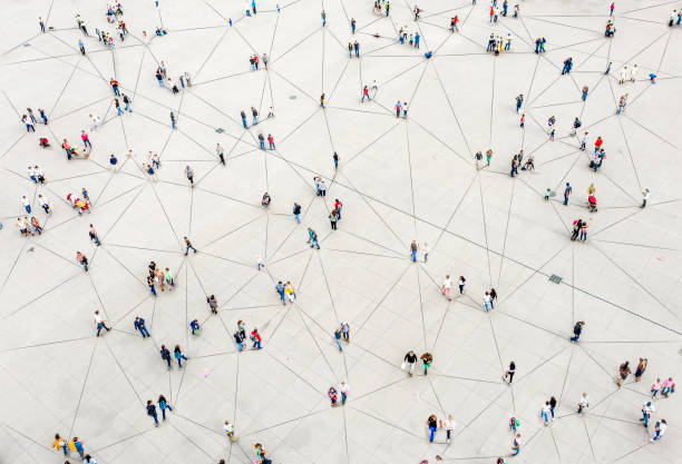 aerial view of crowd connected by lines - crowded stock pictures, royalty-free photos & images