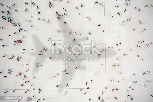 1180187740istockphoto Aerial view of crowd with airplane shadow 1180390323