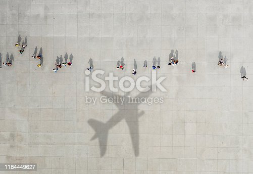 1180187740istockphoto Aerial view of crowd with airplane shadow 1184449627