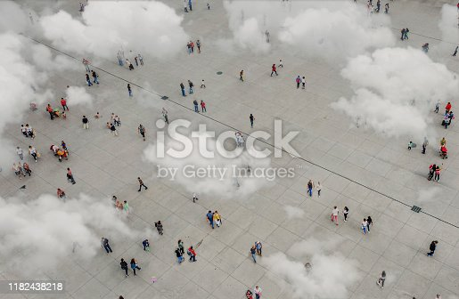 1180187740istockphoto Aerial view of crowd with clowds 1182438218