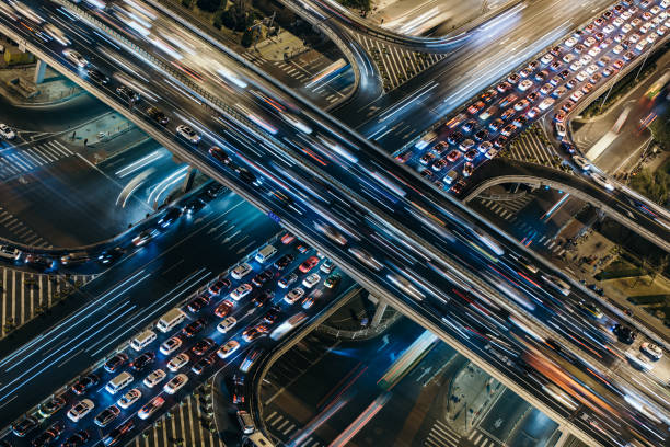 Aerial View of Crowded Traffic at Night Aerial View of Beijing Traffic Jam multiple lane highway stock pictures, royalty-free photos & images