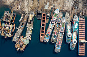 Aerial view of cruise ships being broken down for scrap