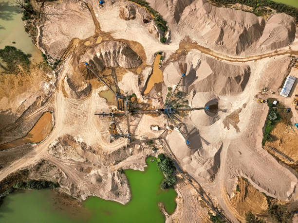 Aerial view of crushed stone quarry machine Top view of crushed stone quarry machine. quarry stock pictures, royalty-free photos & images