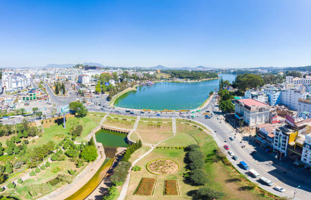Aerial view of Da Lat city beautiful tourism destination in central highlands Vietnam. Clear blue sky. Urban development texture, green parks and city lake. stock photo