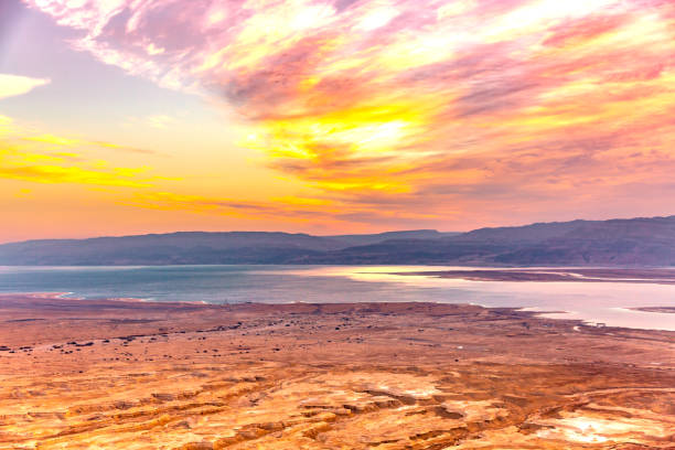 Aerial View of Dead Sea coastline, Israel This pic shows aerial View of Dead Sea coastline in israel. Dead sea is in israel and jordan and famous place for visitors. This pic shows Dead Sea seashore  and mountains on background with sunset sky. The pic is taken in day time and in January 2019. historical palestine stock pictures, royalty-free photos & images