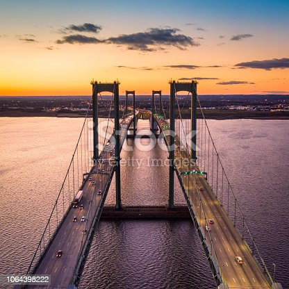 Aerial view of Delaware Memorial Bridge at dusk. The Delaware Memorial Bridge is a set of twin suspension bridges crossing the Delaware River between the states of Delaware and New Jersey