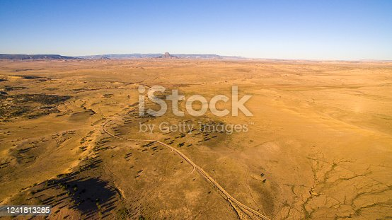 Aerial view of desert under clear sky