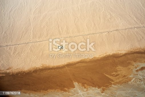 Aerial view of desert, road and lonely house on Sinai Peninsula near Sharm El Sheikh, Egypt