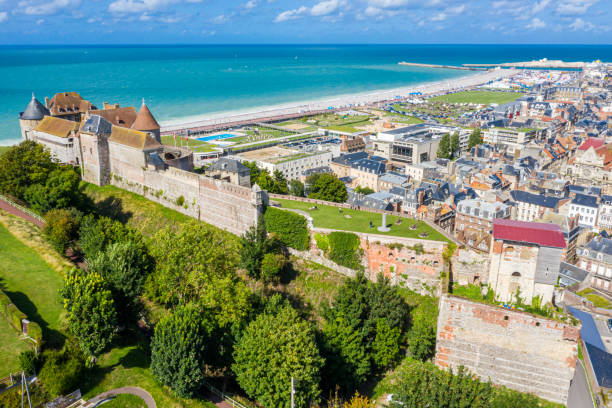 Aerial view of Dieppe town, the fishing port on the English Channel, at the mouth of Arques river. On a clifftop overlooking pebbly Dieppe Beach is the centuries-old Chateau de Dieppe, now the museum Aerial view of Dieppe town, the fishing port on the English Channel, at the mouth of Arques river. On a clifftop overlooking pebbly Dieppe Beach is the centuries-old Chateau de Dieppe, now the museum. dieppe france stock pictures, royalty-free photos & images