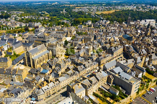 Scenic aerial view of summer cityscape of Dinan overlooking Gothic building of Catholic Church of Saint Malo, France