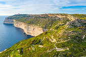 Aerial view of Dingli cliffs. Greeny nature and blue sea and sky. Malta