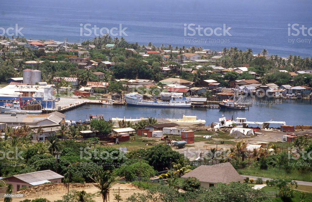 Aerial view of docks piers and boats in harbor town of French Harbor Roatan Bay Islands Honduras stock photo