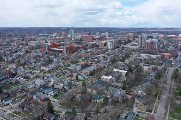 Aerial View of Downtown Ann Arbor, Michigan Aerial view of downtown Ann Arbor and surrounding neighborhoods. ann arbor stock pictures, royalty-free photos & images