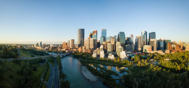 Aerial View of Downtown Calgary Aerial panoramic view of a beautiful modern cityscape during a vibrant sunny sunrise. Taken in Calgary Downtown, Alberta, Canada. alberta stock pictures, royalty-free photos & images