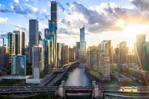 Aerial View of Downtown Chicago at Sunset Chicago Riverwalk at Sunset - Cityscape - June 2019 chicago stock pictures, royalty-free photos & images