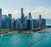Aerial View of Downtown Chicago and Lake Shore in Summer flying over Lake Michigan