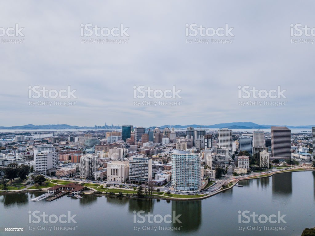 Aerial view of downtown Oakland with SF in distance stock photo