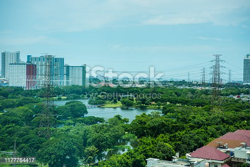 Aerial view of downtown of Jakarta, with a lake and golf course and residential houses and morden buildings.